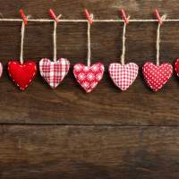 Love hearts made from various materials hung from string