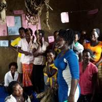 Volunteer Namata running teacher training in Uganda