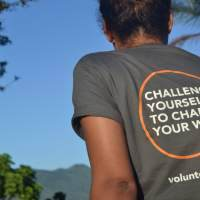 The back of an ICS t-shirt saying 'Challenge yourself to change your world'.