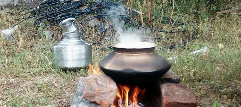 rice cooking on a fire