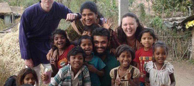 Pravah ICS volunteer Ruairi Kerrigan alongside local children