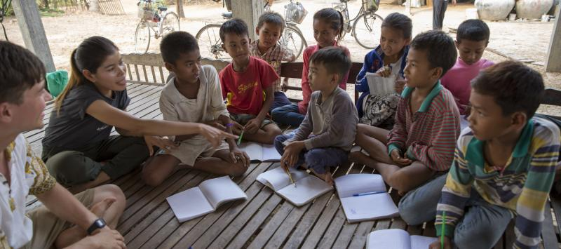 VSO ICS volunteers run a weekly English class for all children in the village at their host home