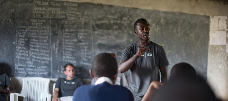 A Balloon Ventures volunteer talks to students at Bagara Secondary school in Njoro