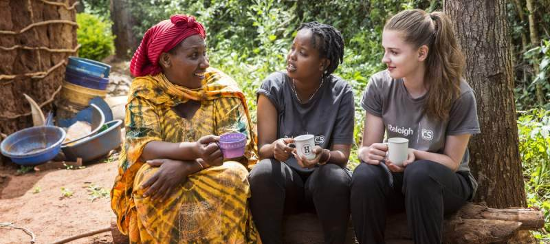 Volunteers Frida and Cathryn chat to their host Mother Agnes in their host home in Mbulu, Tanzania