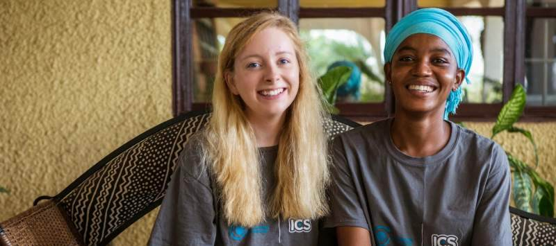 While on placement you will live with a counterpart, like Ghanaian volunteer Fauzia and UK volunteer Claire, pictured outside their host home