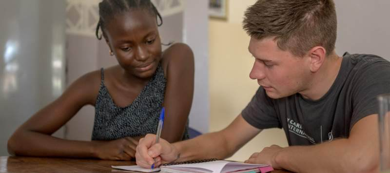 Aude teaches UK volunteer Brandon Johnstone some basics of local language Wolof