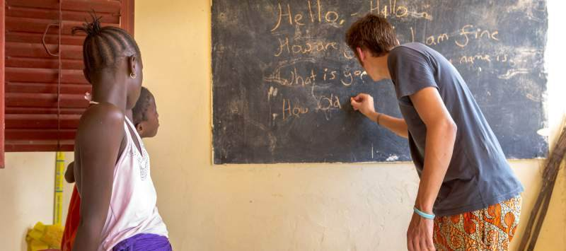 ICS volunteer Will Warrilow teaches English to the children of his host family in Ziguinchor, Senegal