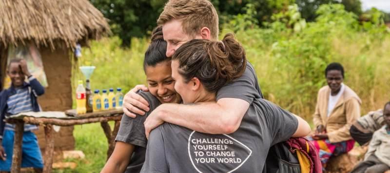 Volunteers hug on placement