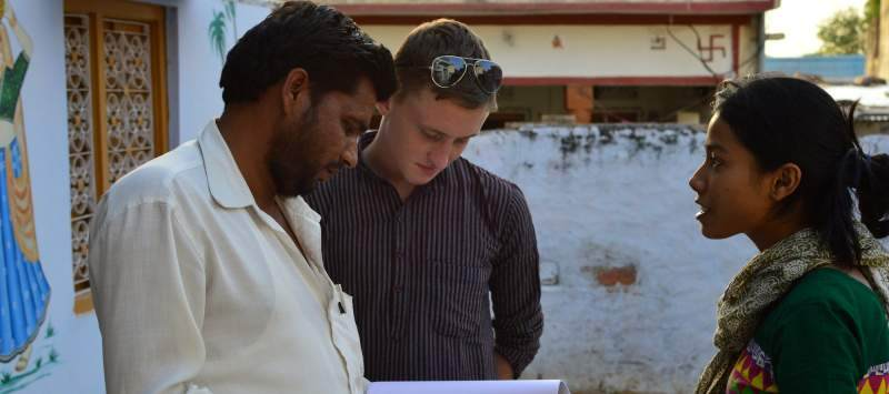 Volunteer Jamie Phillips talks to a local government official in Paner, Rajasthan