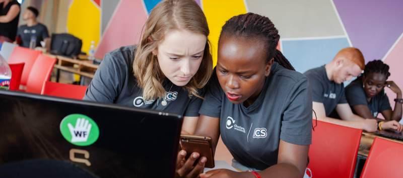 Challenges volunteers look over laptop