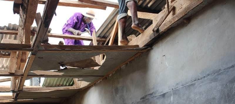 Local host parent and carpenter Noah Adegbamigbe was hired to repair the roof