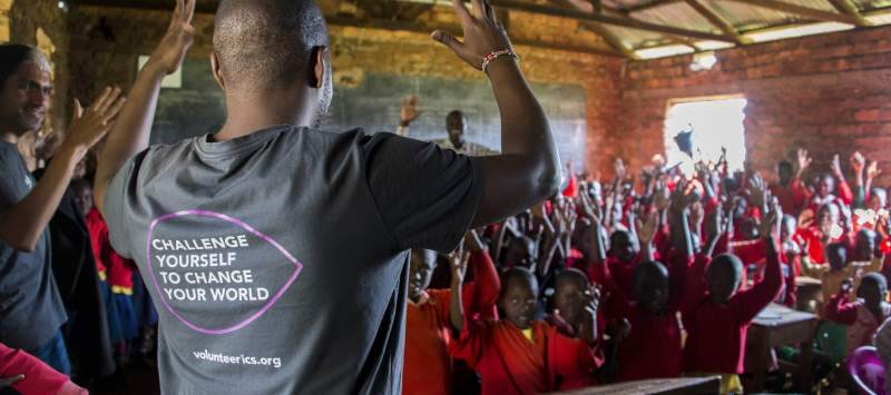 A volunteer teaches Kenyan Sign Language to learners in school.