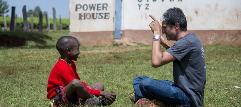 Volunteer teaching sign language to Victor