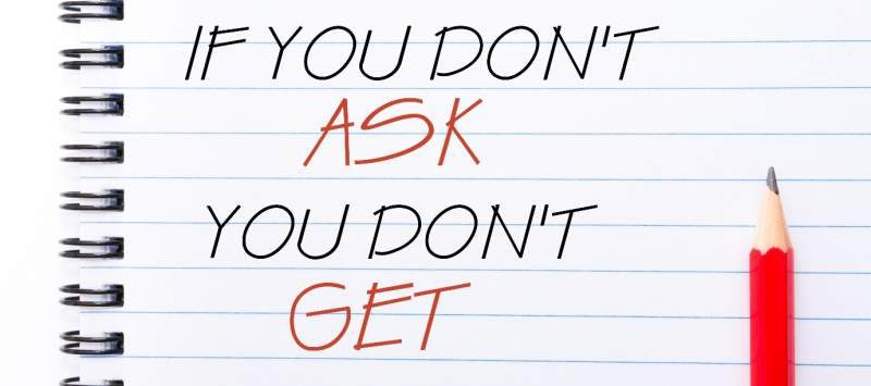 'If You Don't Ask You Do Not Get' written on notebook page with a red pencil on the right.