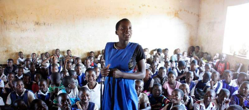 A girl answers a question during an ICS session on the importance of education