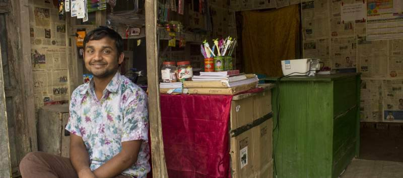 Stationery shop owner Hemonto Kumar Roy, 23, was earning just BDT100 (£0.90) per day before ICS volunteers started working with him. Now his income has quadrupled.