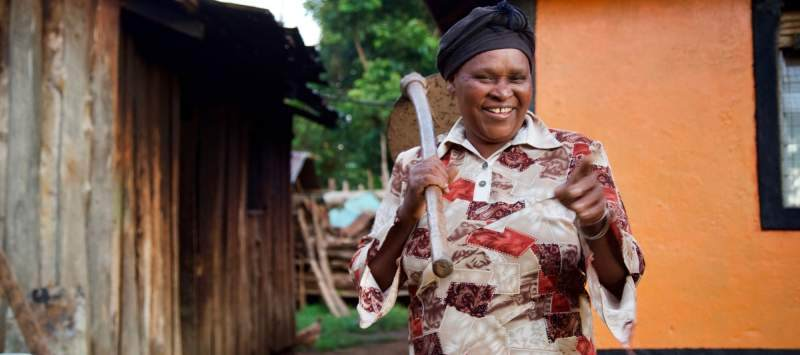 Mama Helen stands proudly outside her home in Loitokitok, Kenya
