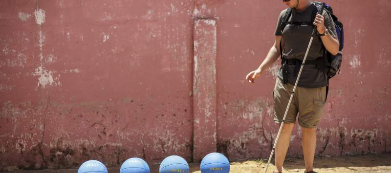 Richard walks near the balls ready for the tournament