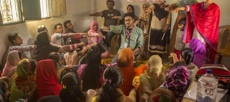 ICS volunteers in northern Bangladesh meet with young people as part of a campaign on early marriage