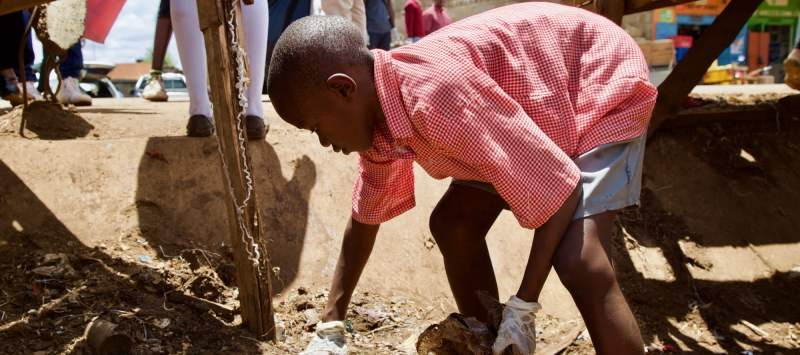 A child in Loitokitok, Kenya, takes part in a clean-up organised by ICS volunteers