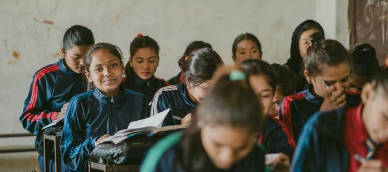 Young girls sat in a classroom in Nepal