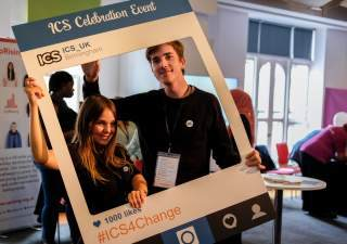 Two ICS volunteers pose at an event organised to celebrate the impact of ICS