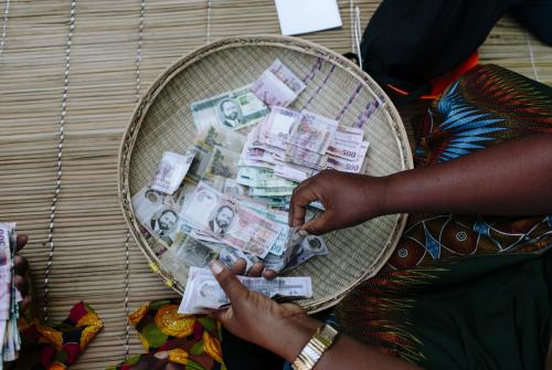Counting money in Mozambique