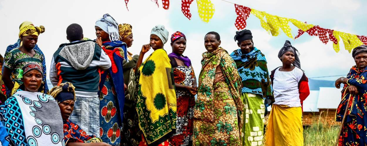 women in colourful clothes outside