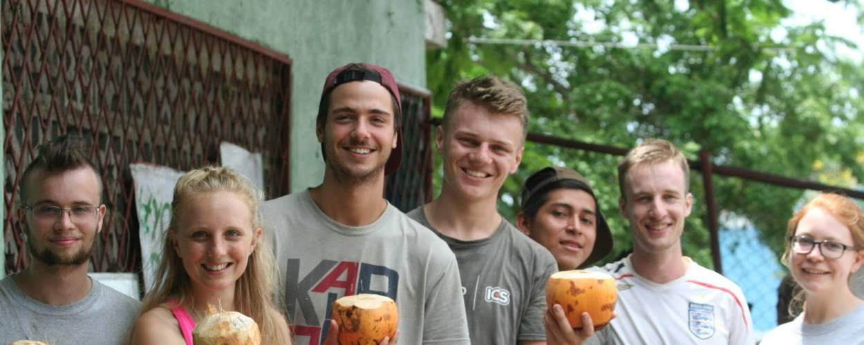 volunteers drinking from coconuts