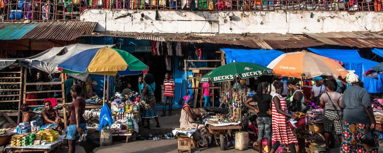 People shop at stores in the Waterside Market of Liberia's capital, Monrovia
