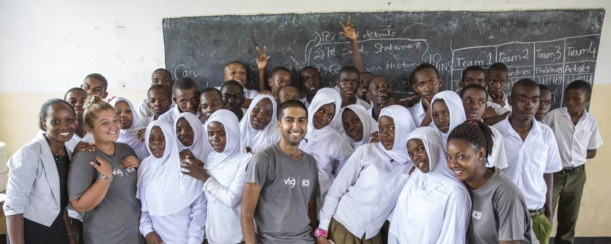 Volunteers with children at Angaza school, Tanzania