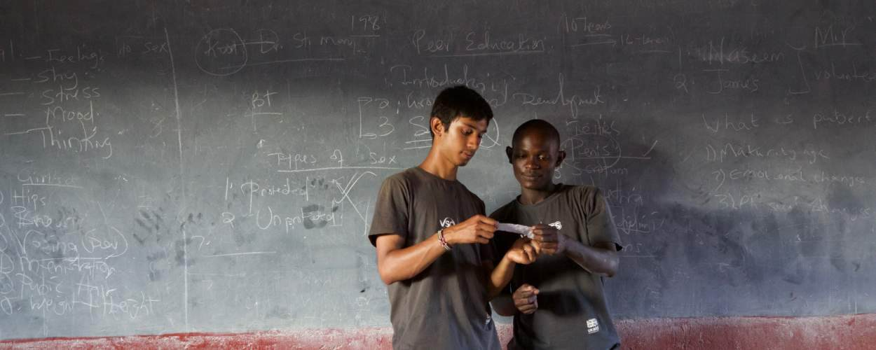 Volunteers Naseem and James deliver a sexual health session in a school near Loitokitok, Kenya
