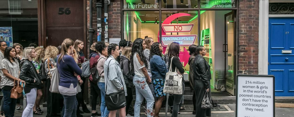 Activists queue to be turned away from a fake contraceptive clinic for a stunt