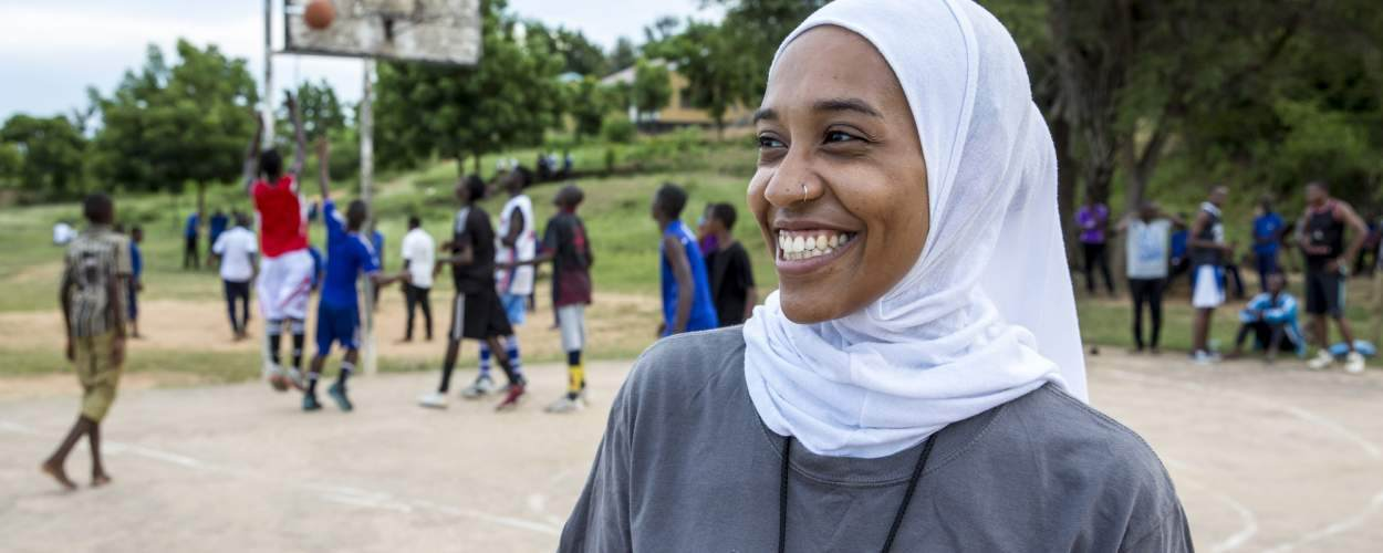 VSO ICS volunteer Asma Elbadawi during an evening training session with students from Lindi secondary school, Tanzania