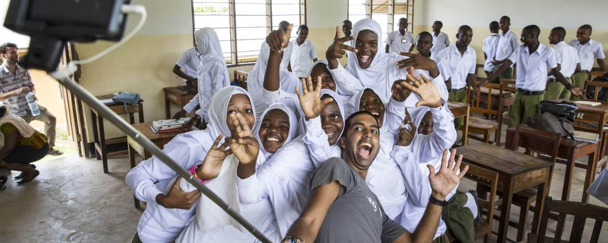 Bharat Thakrar poses for a selfie with students he has been working with at Angaza school, Lindi, Tanzania