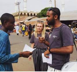 Project officer Hassan talks with comunity members on the street