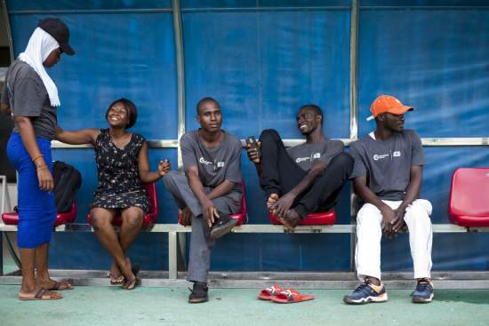 Volunteers relax at the stadium in Tamale before the tournament