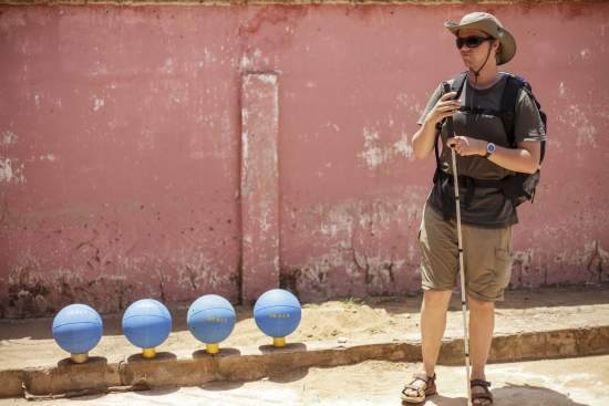 Volunteer Richard Wheatley stands by the balls in the hours before the tournament