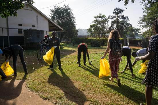 VSO ICS volunteers clean the grounds of a local hospital