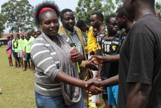 Project coordinator Jane Muthoni chairs a football match between volunteers and young people