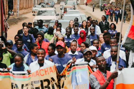 Volunteers in Machakos march through the town centre