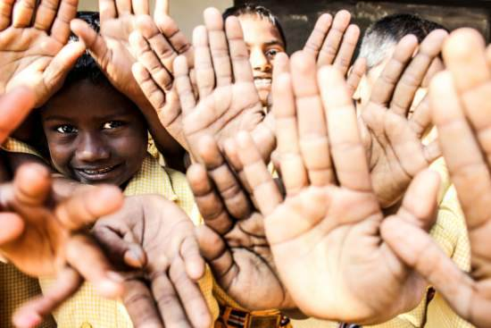 Indian children show their washed hands proudly