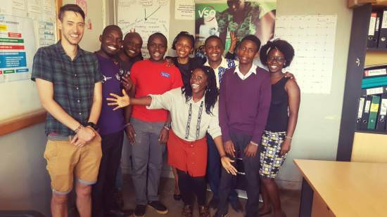 Takyiwa stands with a group of young people from Kenya in a classrooom