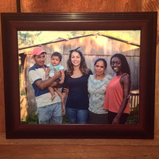 Framed picture of volunteers and host family