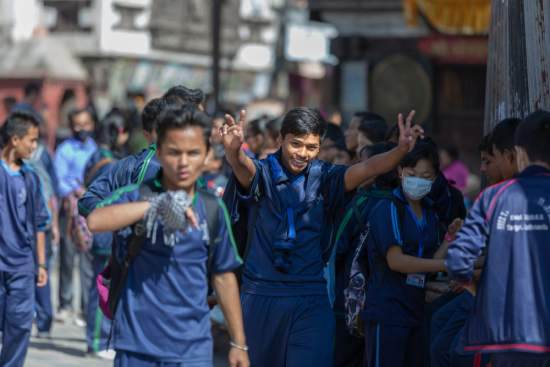 Young people in Kathmandu walk down the street