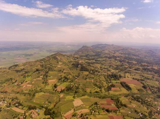 A drone shot of a beautiful green hilly Kenyan landscape