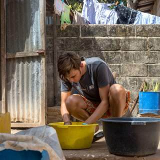 A volunteer washing his clothes