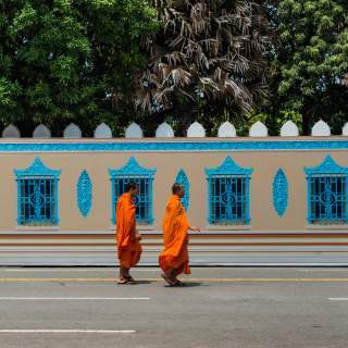 Two monks cross the street in Cambodia