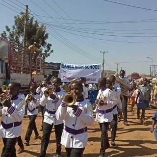 Mupenzi brass band take part in a parade