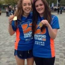 Ciara and her friend celebrating completing a half marathon.